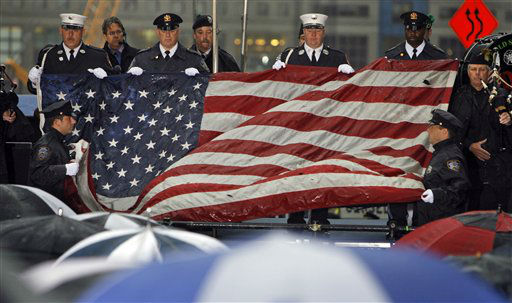 "<div class=""meta image-caption""><div class=""origin-logo origin-image none""><span>none</span></div><span class=""caption-text"">The World Trade Center flag is folded after being presented at the commemoration ceremony on the eighth anniversary in 2009. (AP Photo/ Jason DeCrow)</span></div>"