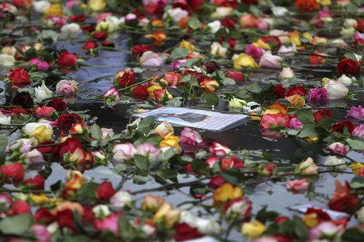 "<div class=""meta image-caption""><div class=""origin-logo origin-image none""><span>none</span></div><span class=""caption-text"">A photo of firefighter Scott Larsen floats amid roses in the reflecting pool during the the eighth anniversary commemoration ceremony in 2009. (AP Photo/ Chang W. Lee)</span></div>"