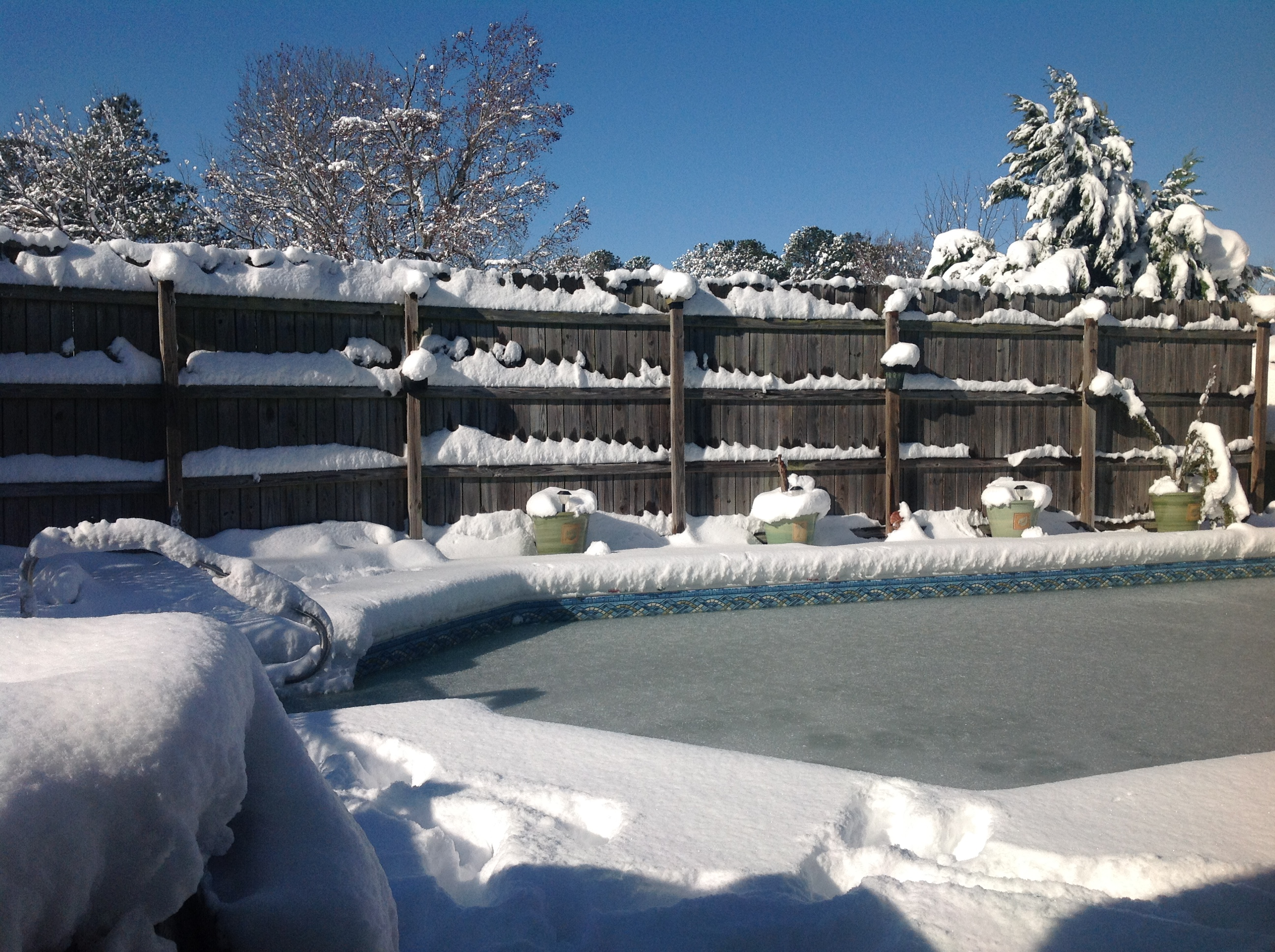 "<div class=""meta image-caption""><div class=""origin-logo origin-image wtvd""><span>WTVD</span></div><span class=""caption-text"">No swimming for a while - 8 inches of snow in Durham! (Linda from Durham - ABC11 Eyewitness)</span></div>"