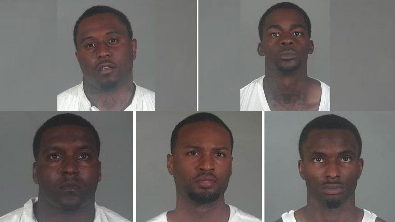 Robbery suspects Darrian Haywood, 27, Adrian Caldwell, 26, Shai Fields, 24, Sebastian Glass, 20, and Trey Dickerson, 25, are shown in mugshots.