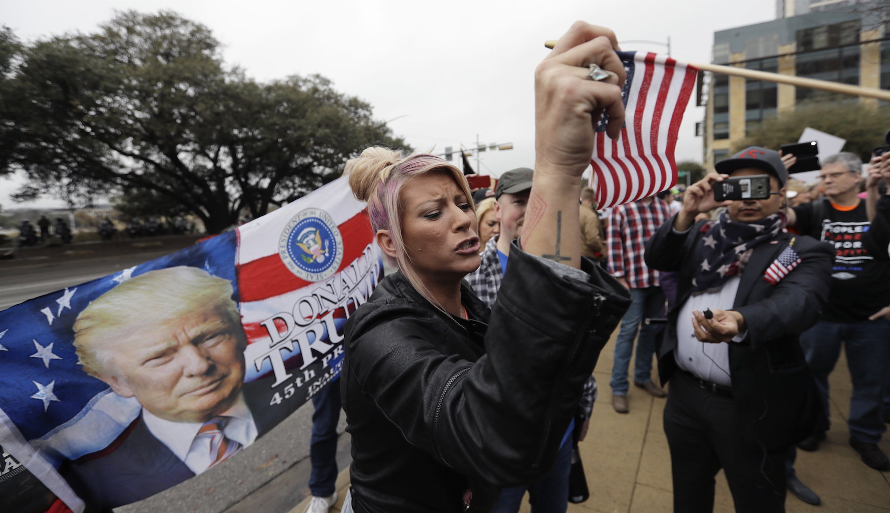 <div class='meta'><div class='origin-logo' data-origin='AP'></div><span class='caption-text' data-credit='AP Photo/Eric Gay'>A supporter of President Donald Trump argues with others at a rally before a women's march, Saturday, Jan. 20, 2018, in Austin, Texas.</span></div>