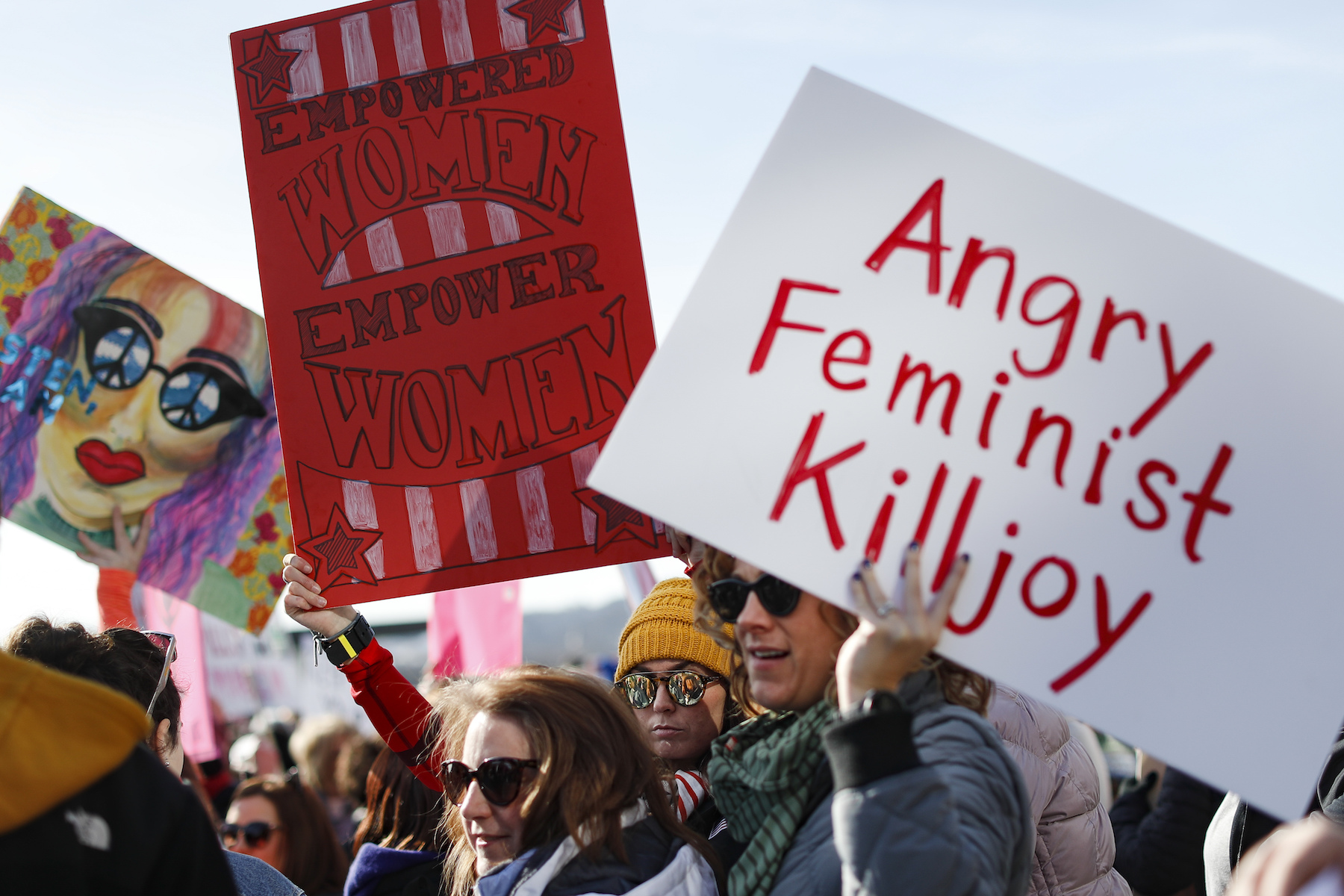 <div class='meta'><div class='origin-logo' data-origin='AP'></div><span class='caption-text' data-credit='AP Photo/John Minchillo'>Protestors gather to participate in a Women's March highlighting demands for equal rights and equality for women, Saturday, Jan. 20, 2018, in Cincinnati.</span></div>
