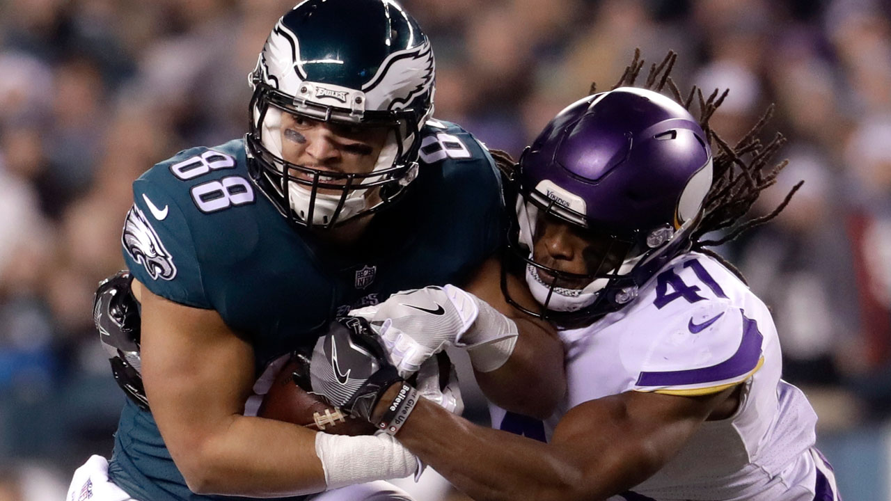 Philadelphia Eagles' Trey Burton catches a pass in front of Minnesota Vikings' Anthony Harris during the NFL football NFC championship game Sunday, Jan. 21, 2018, in Philadelphia.