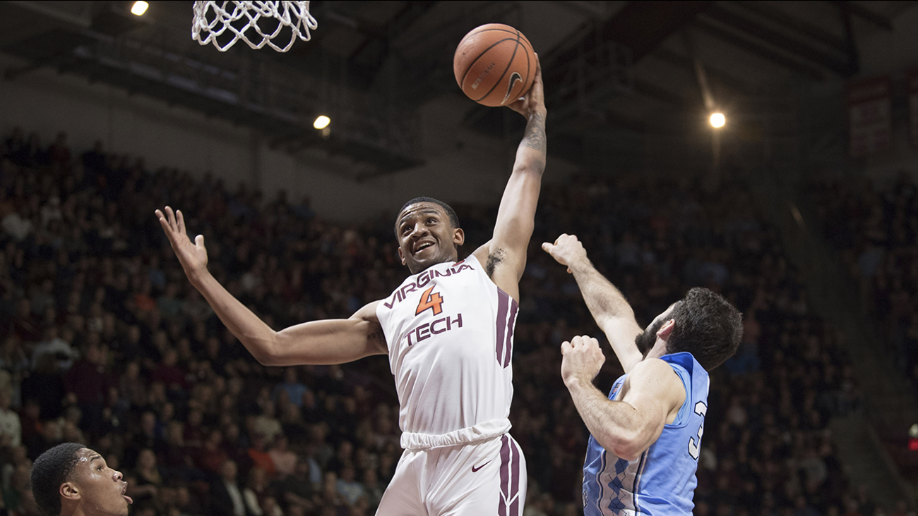 Virginia Tech's Nickel Alexander-Walker grabs rebound in front of North Carolina's Luke Maye on Monday in Blacksburg, Va.