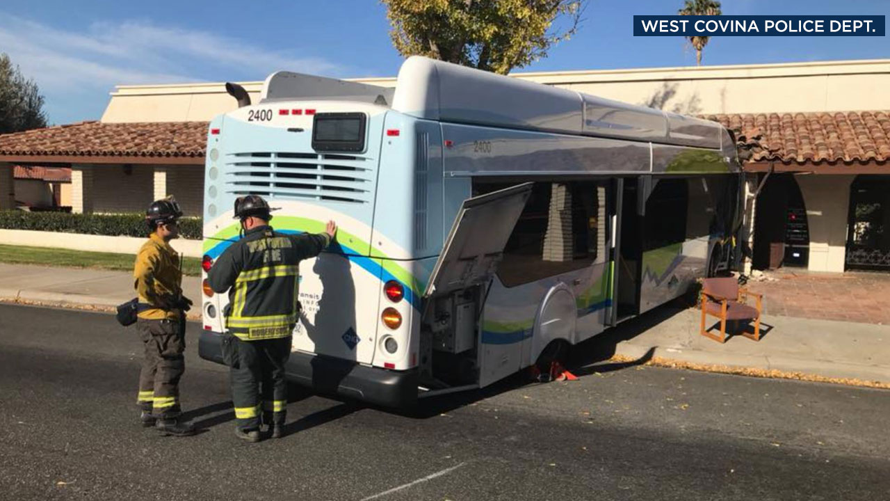 Firefighters look over the damage after a transit bus crashed into a building in West Covina on Wednesday, Jan. 24, 2018.