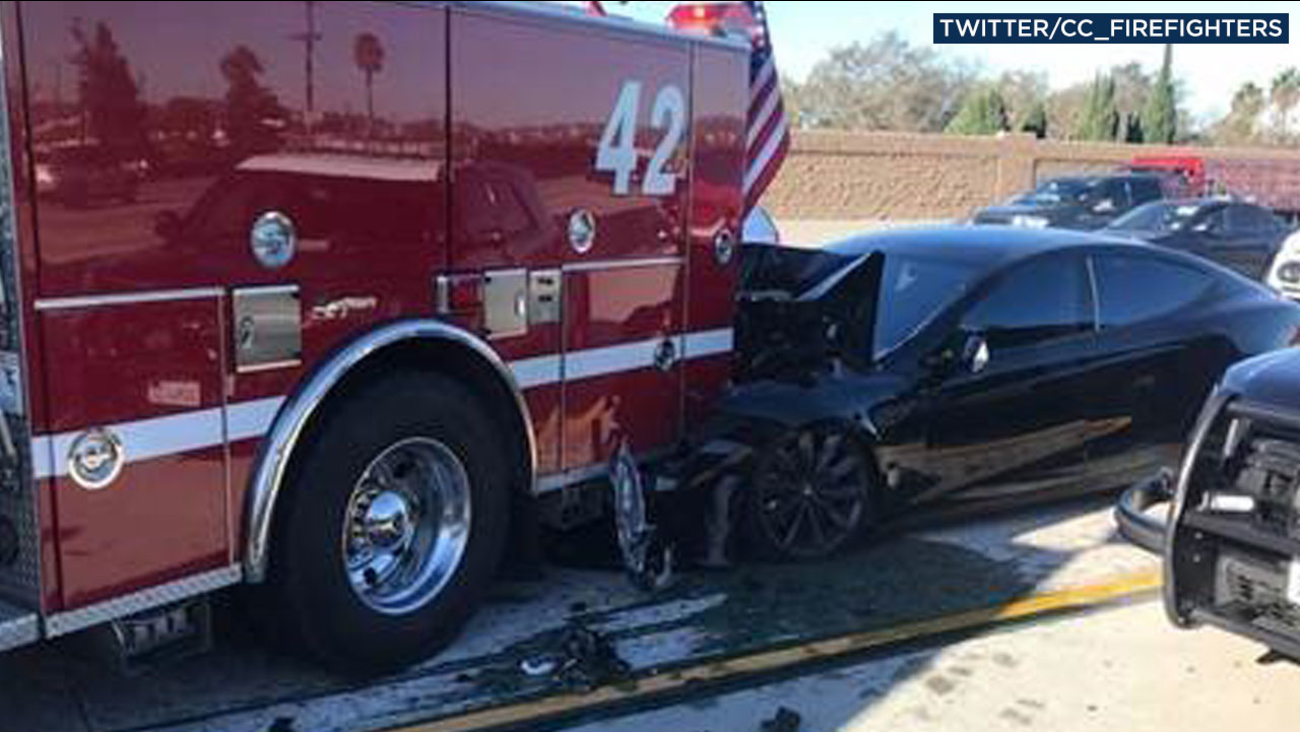 A mangled Tesla Model S is shown on the 405 Freeway after it crashed into the back of a Culver City fire truck in Culver City on Monday, Jan. 22, 2018.