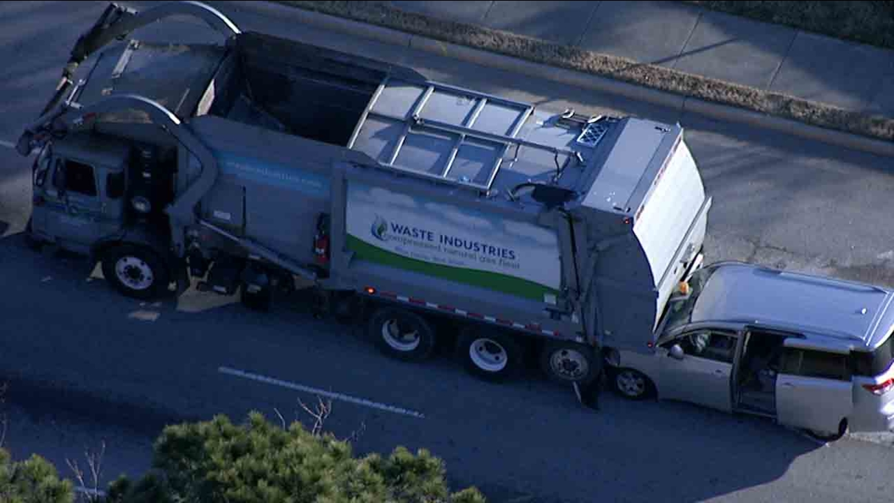 1 person injured after van rams into garbage truck