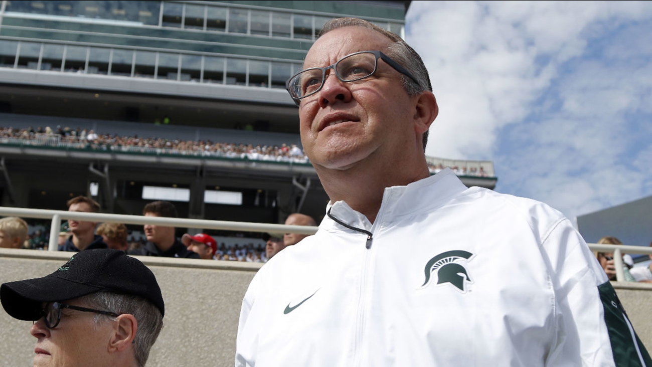 In this Sept. 24, 2016, file photo, Michigan State University athletics director Mark Hollis watches the action during a football game against Wisconsin, in East Lansing, Mich.