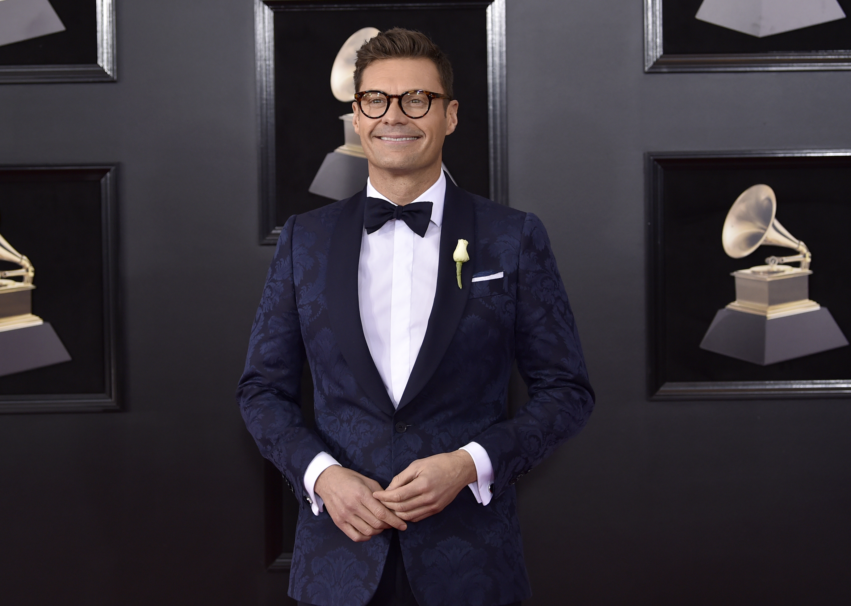 <div class='meta'><div class='origin-logo' data-origin='AP'></div><span class='caption-text' data-credit='Evan Agostini/Invision/AP'>Ryan Seacrest arrives at the 60th annual Grammy Awards at Madison Square Garden on Sunday, Jan. 28, 2018, in New York.</span></div>
