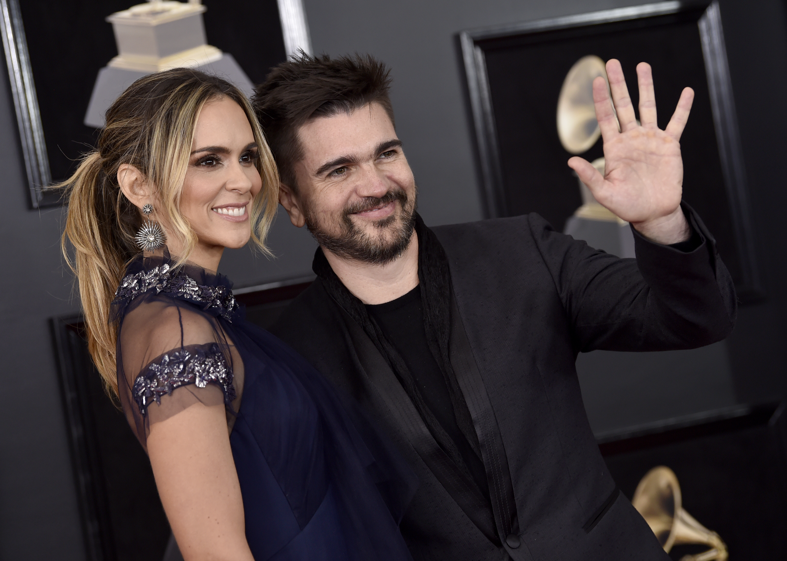 <div class='meta'><div class='origin-logo' data-origin='AP'></div><span class='caption-text' data-credit='Evan Agostini/Invision/AP'>Juanes, right, and Karen Martinez arrive at the 60th annual Grammy Awards at Madison Square Garden on Sunday, Jan. 28, 2018, in New York.</span></div>