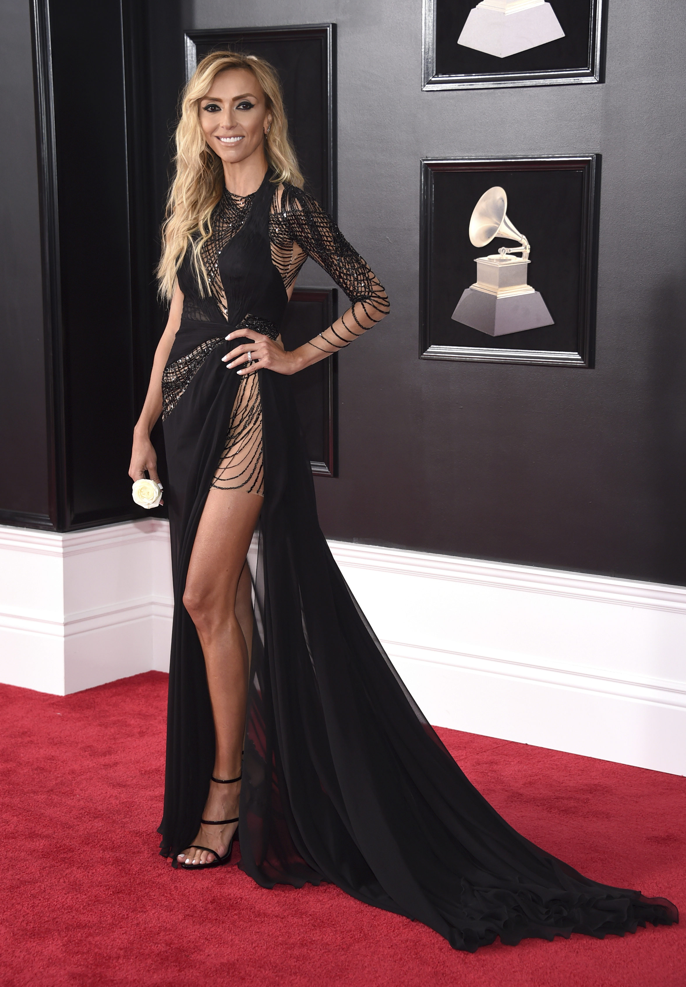 <div class='meta'><div class='origin-logo' data-origin='AP'></div><span class='caption-text' data-credit='Evan Agostini/Invision/AP'>Giuliana Rancic arrives at the 60th annual Grammy Awards at Madison Square Garden on Sunday, Jan. 28, 2018, in New York.</span></div>
