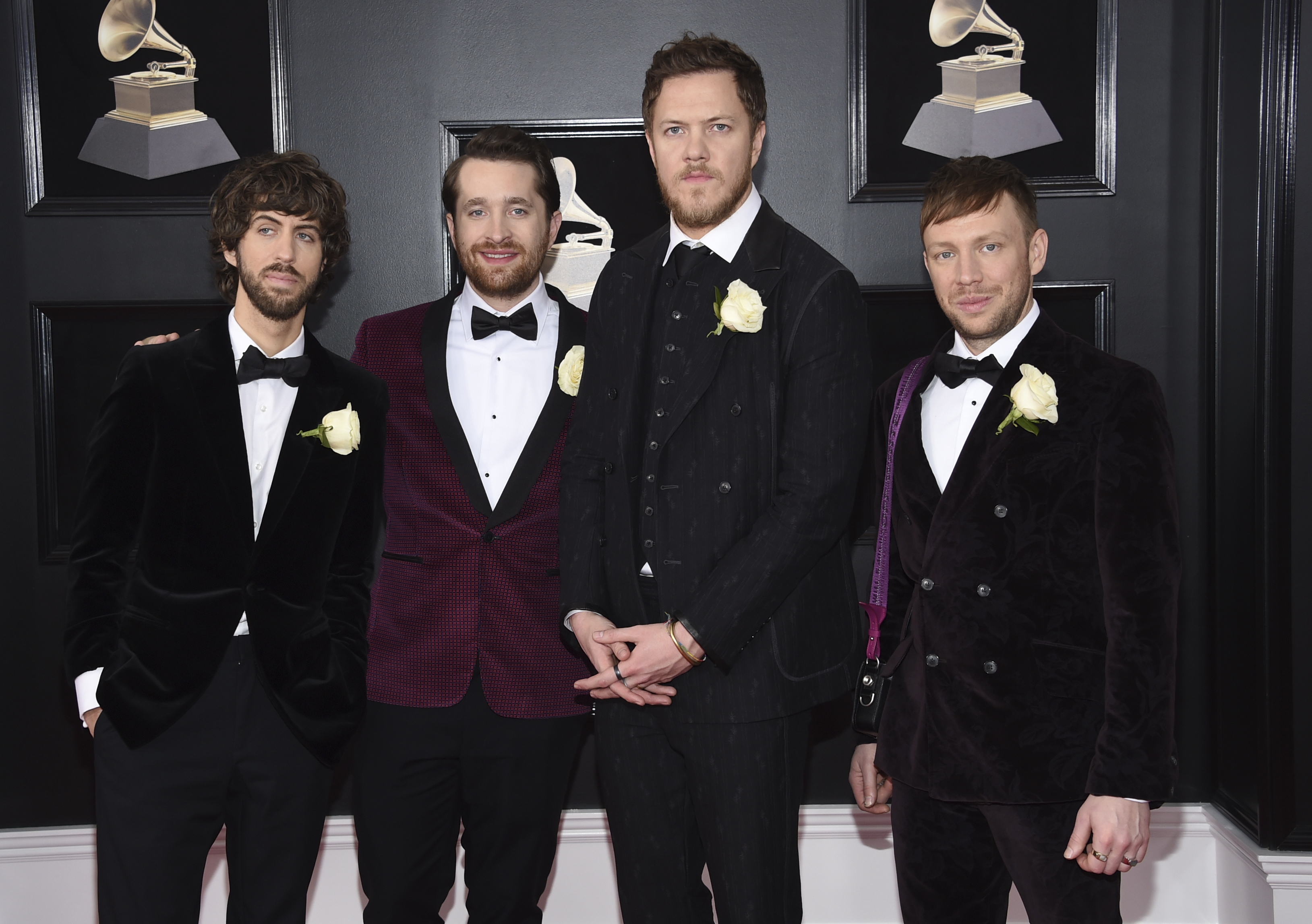 <div class='meta'><div class='origin-logo' data-origin='AP'></div><span class='caption-text' data-credit='Evan Agostini/Invision/AP'>Wayne Sermon, from left, Daniel Platzman, Dan Reynolds, Ben McKee of Imagine Dragons arrives at the 60th annual Grammy Awards at Madison Square Garden on Sunday, Jan. 28, 2018.</span></div>