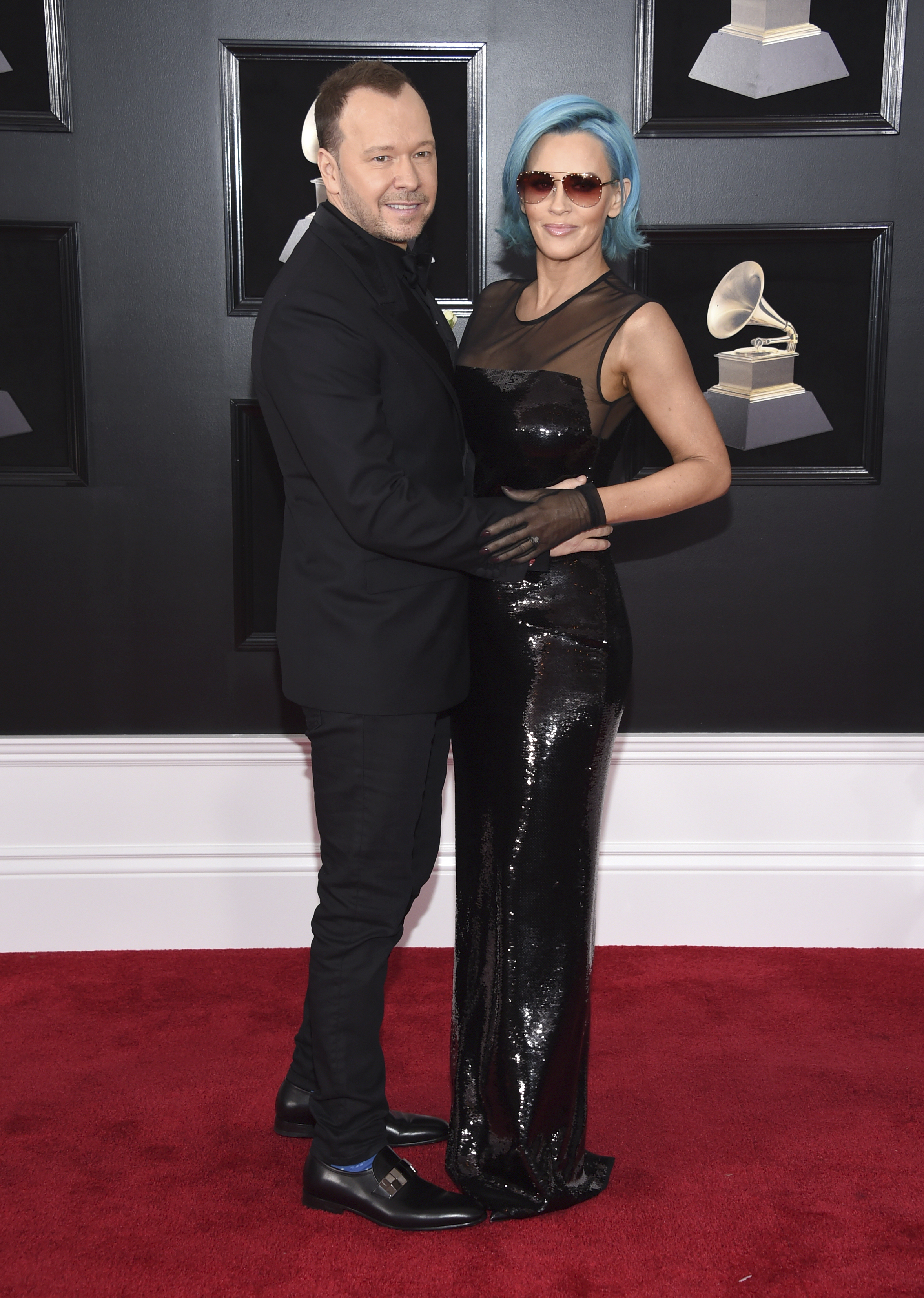 <div class='meta'><div class='origin-logo' data-origin='AP'></div><span class='caption-text' data-credit='Evan Agostini/Invision/AP'>Donnie Wahlberg, left, and Jenny McCarthy arrive at the 60th annual Grammy Awards at Madison Square Garden on Sunday, Jan. 28, 2018, in New York.</span></div>