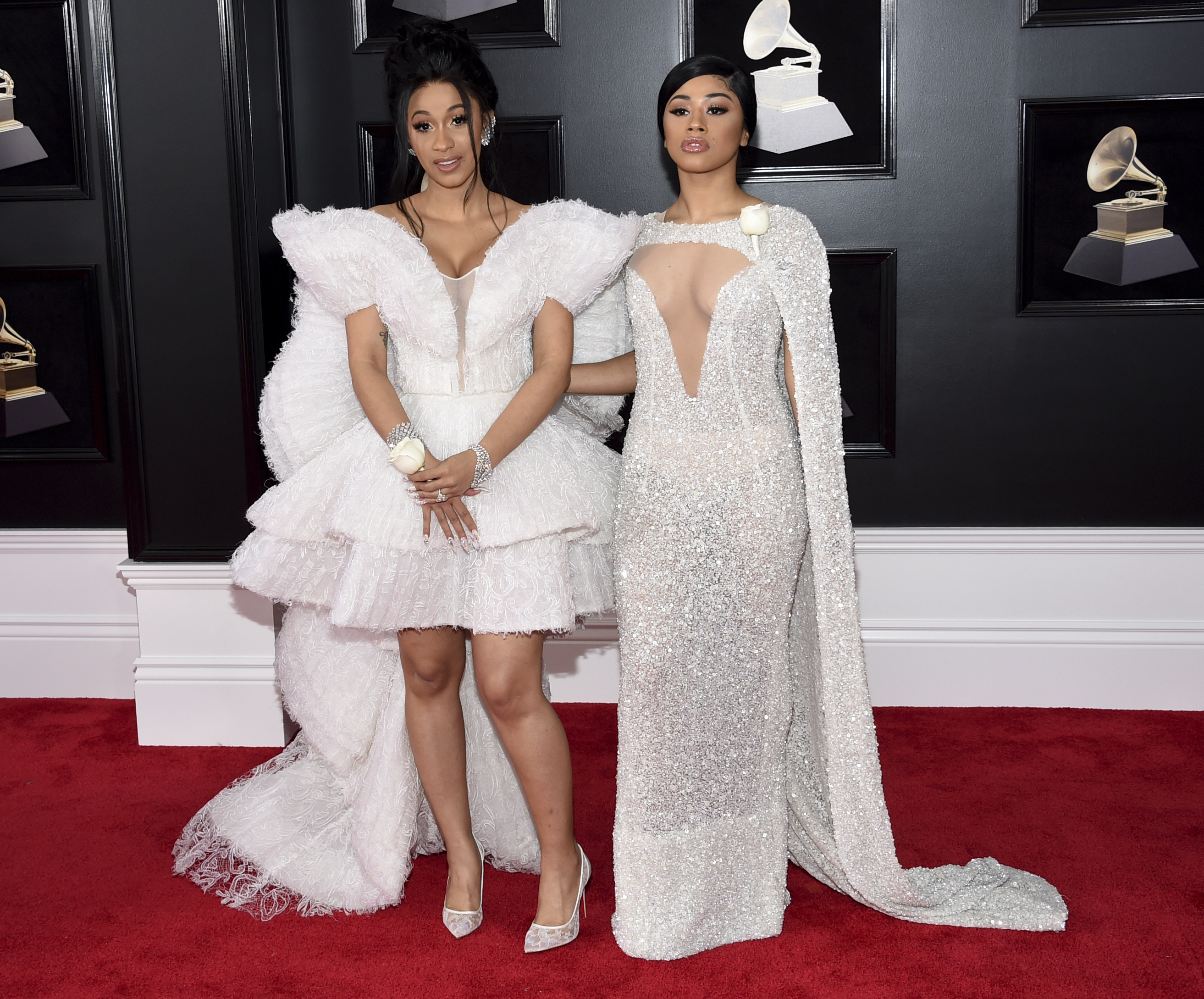 <div class='meta'><div class='origin-logo' data-origin='AP'></div><span class='caption-text' data-credit='Evan Agostini/Invision/AP'>Cardi B, left, and Hennessy Carolina arrive at the 60th annual Grammy Awards at Madison Square Garden on Sunday, Jan. 28, 2018, in New York.</span></div>