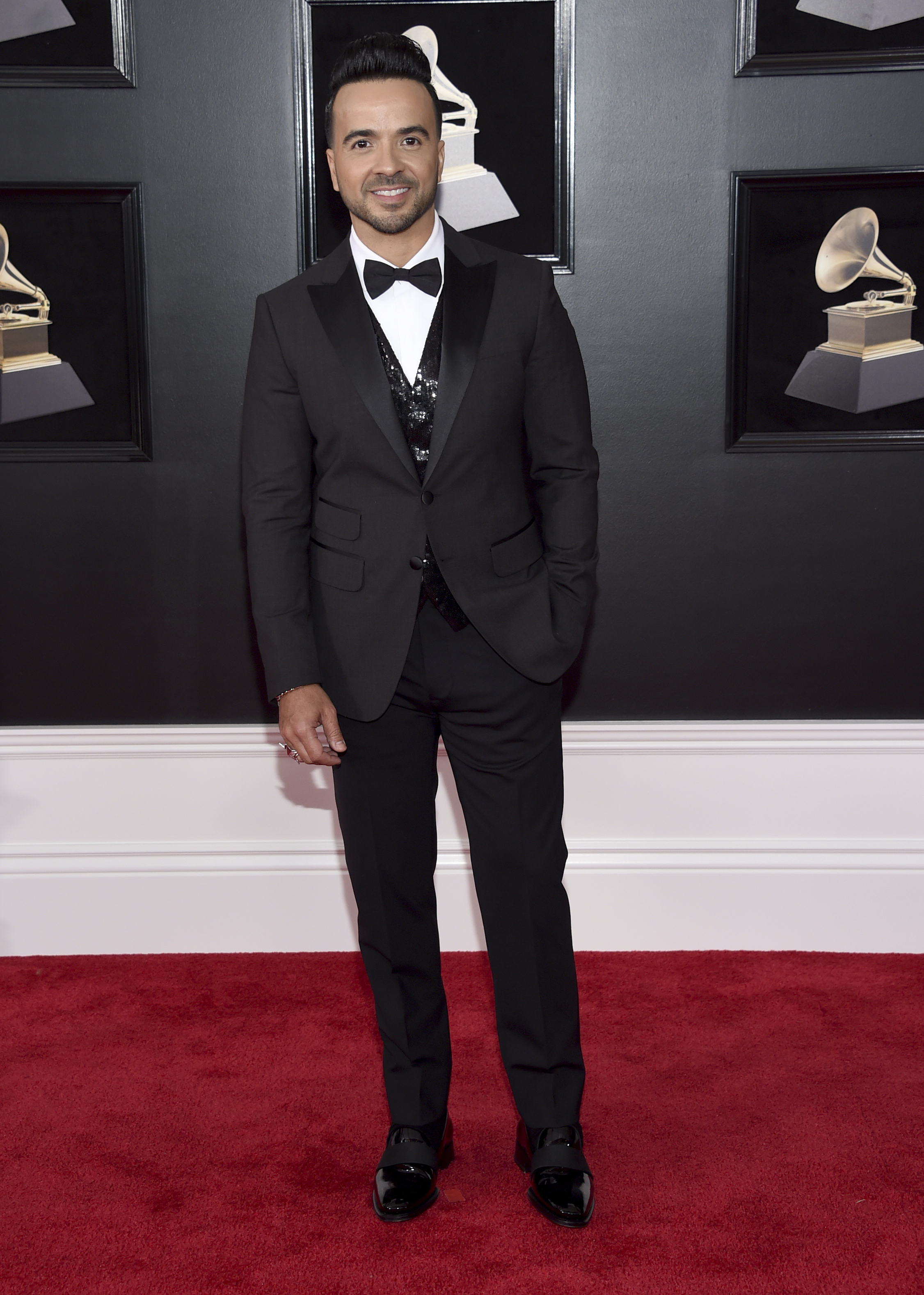 <div class='meta'><div class='origin-logo' data-origin='AP'></div><span class='caption-text' data-credit='Evan Agostini/Invision/AP'>Luis Fonsi arrives at the 60th annual Grammy Awards at Madison Square Garden on Sunday, Jan. 28, 2018, in New York.</span></div>