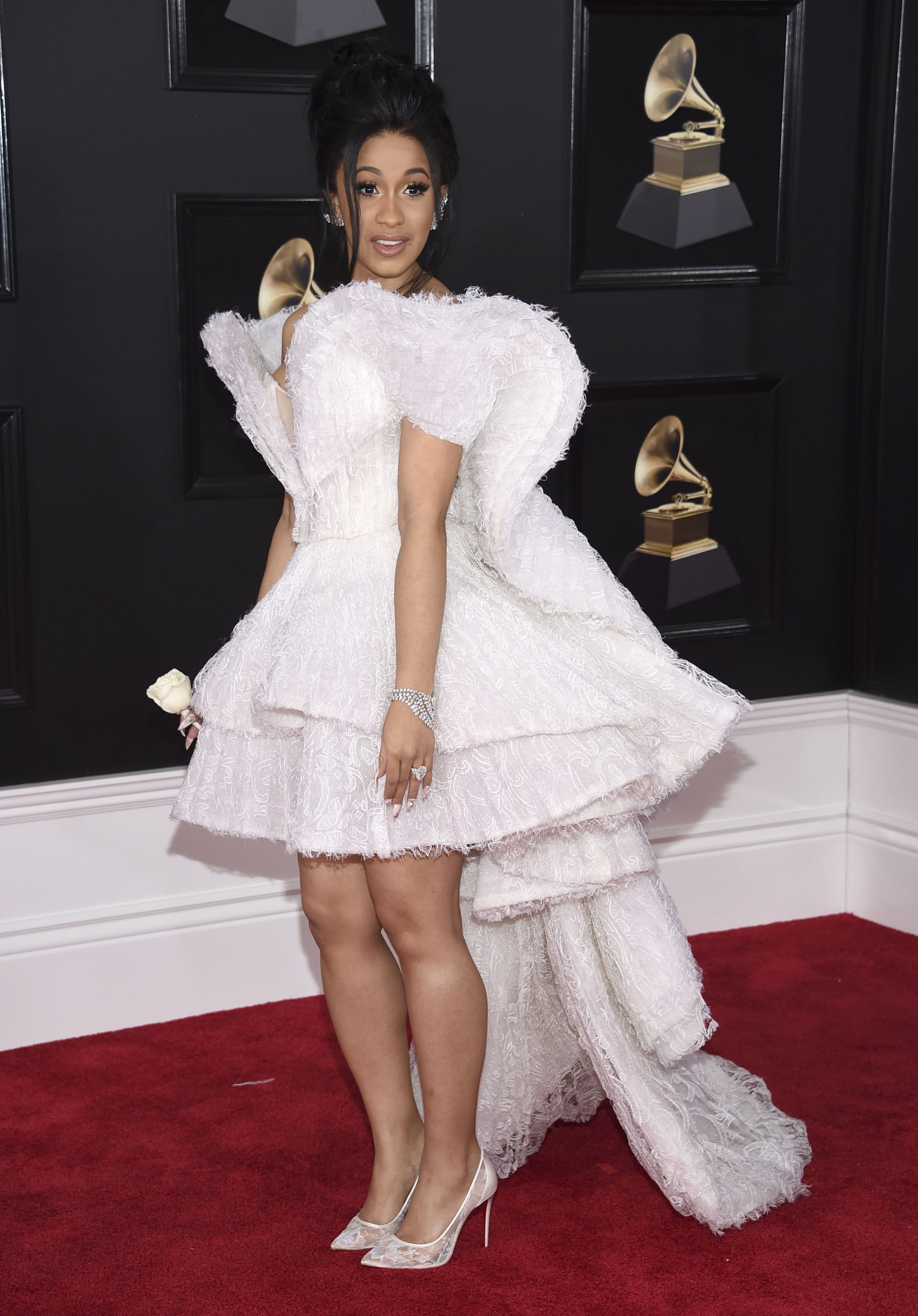 <div class='meta'><div class='origin-logo' data-origin='AP'></div><span class='caption-text' data-credit='Evan Agostini/Invision/AP'>Cardi B arrives at the 60th annual Grammy Awards at Madison Square Garden on Sunday, Jan. 28, 2018, in New York.</span></div>