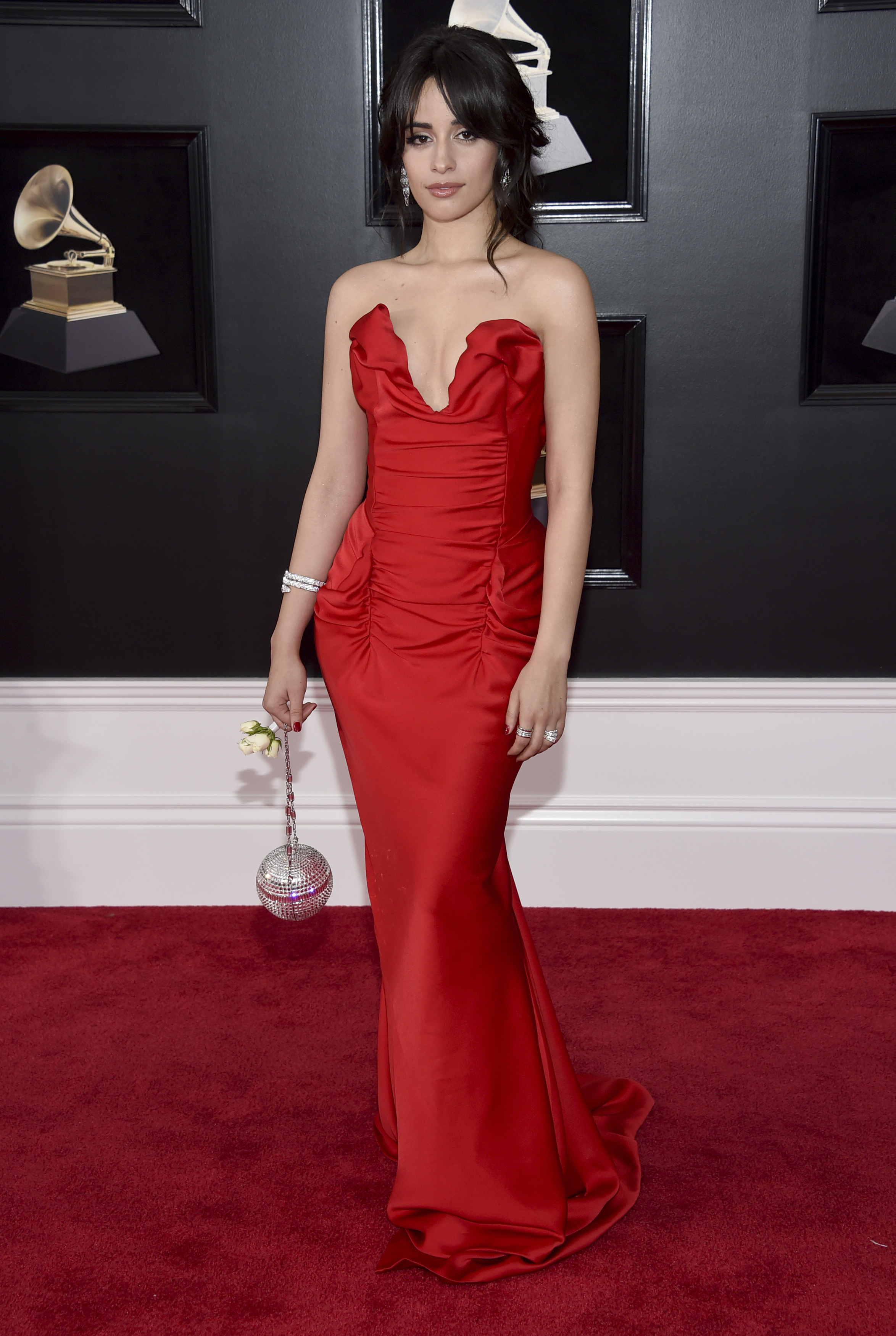 <div class='meta'><div class='origin-logo' data-origin='AP'></div><span class='caption-text' data-credit='Evan Agostini/Invision/AP'>Camila Cabello arrives at the 60th annual Grammy Awards at Madison Square Garden on Sunday, Jan. 28, 2018, in New York.</span></div>