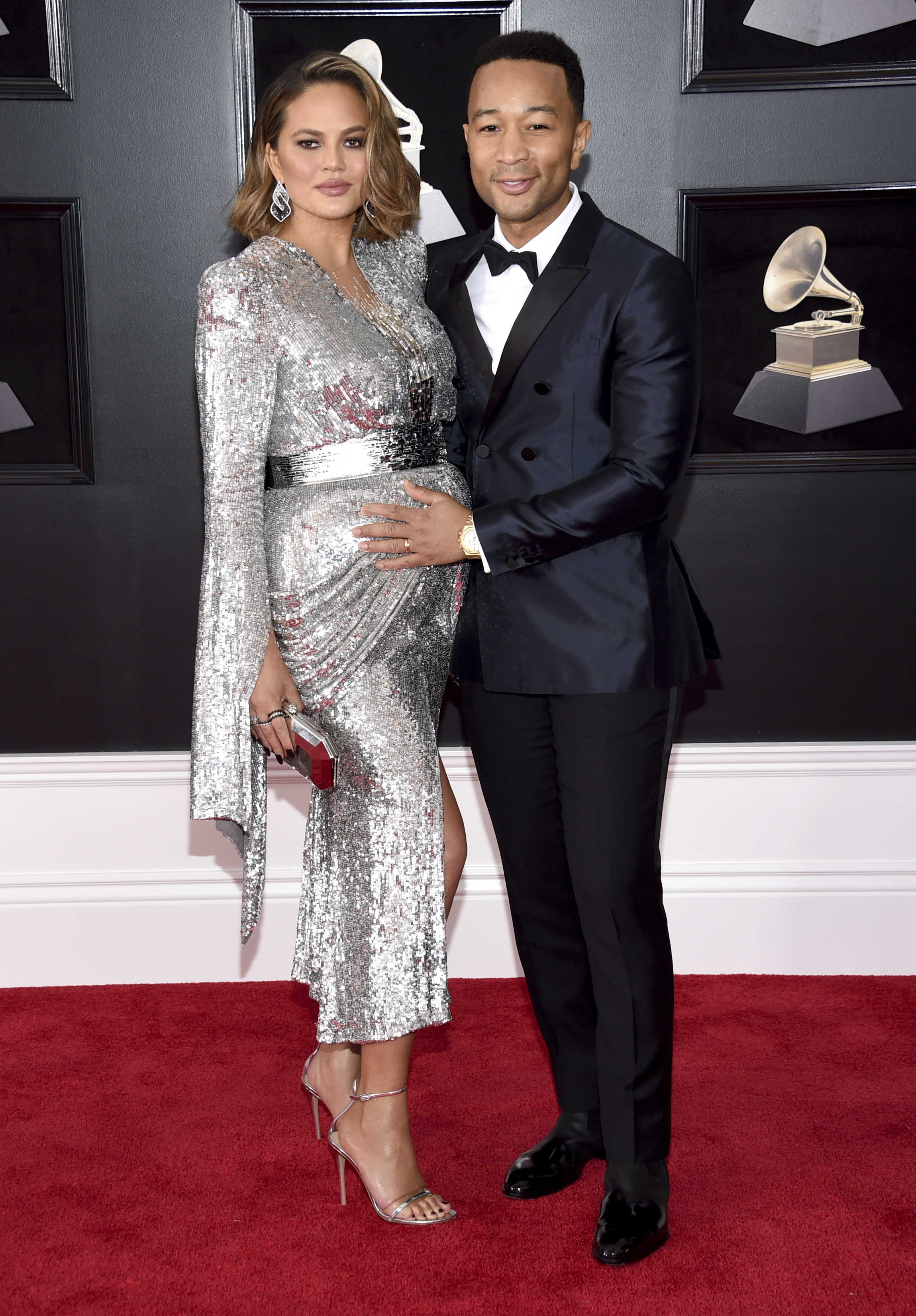 <div class='meta'><div class='origin-logo' data-origin='AP'></div><span class='caption-text' data-credit='Evan Agostini/Invision/AP'>Chrissy Teigen, left, and John Legend arrive at the 60th annual Grammy Awards at Madison Square Garden on Sunday, Jan. 28, 2018, in New York.</span></div>