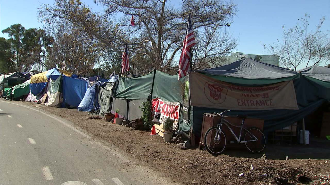 An estimated 1,000 people live in a large homeless encampment along the Santa Ana River Trail.