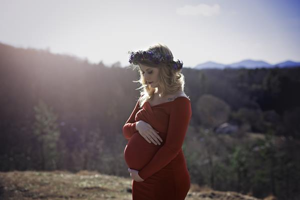 <div class='meta'><div class='origin-logo' data-origin='none'></div><span class='caption-text' data-credit='Credit: Erin and Kendra/PinehurstNC Photography'>Brittany Harris poses with her unborn daughter solo after her husband was killed during a suicide bombing attack in Afghanistan</span></div>