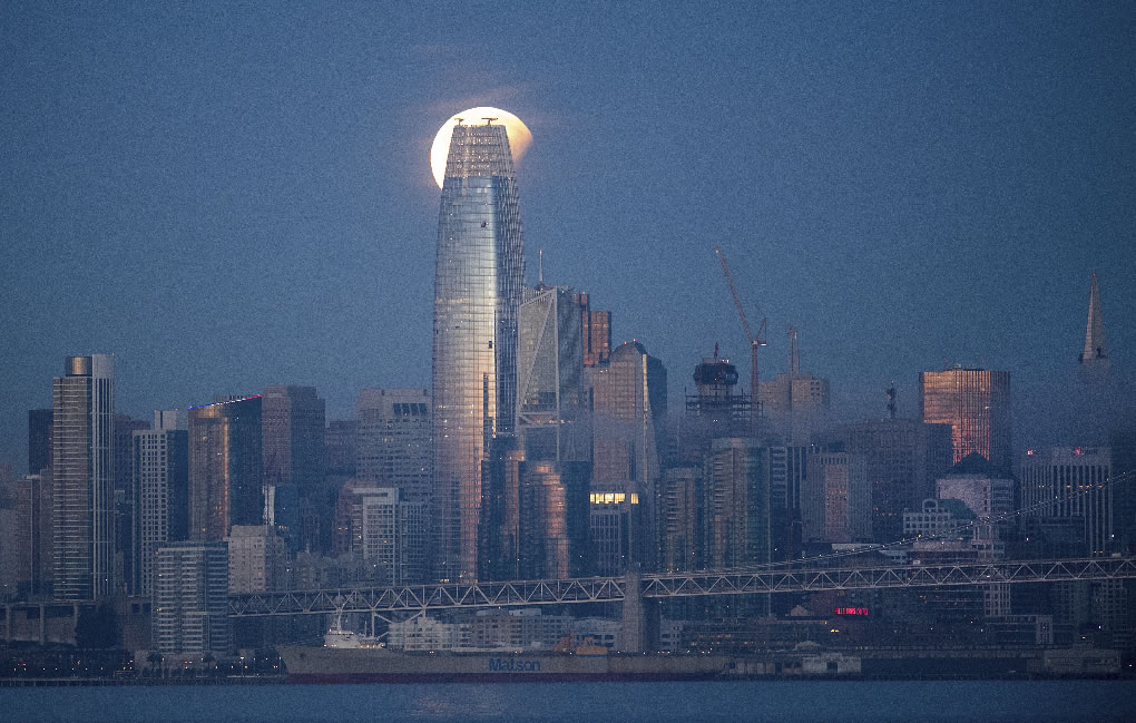 <div class='meta'><div class='origin-logo' data-origin='none'></div><span class='caption-text' data-credit='AP Photo/Noah Berger)'>A partially-eclipsed super blue blood moon sets behind the Salesforce Tower on Wednesday, Jan. 31, 2018, in San Francisco.</span></div>