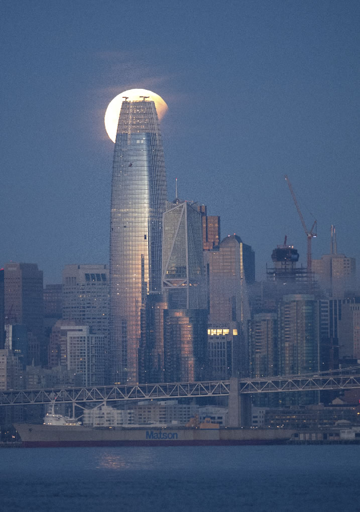 <div class='meta'><div class='origin-logo' data-origin='none'></div><span class='caption-text' data-credit='AP Photo/Noah Berger'>A partially-eclipsed super blue blood moon sets behind the Salesforce Tower on Wednesday, Jan. 31, 2018, in San Francisco.</span></div>