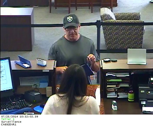 The 'Hills Bandit' is seen at a bank in Lake Forest on July 25, 2014.