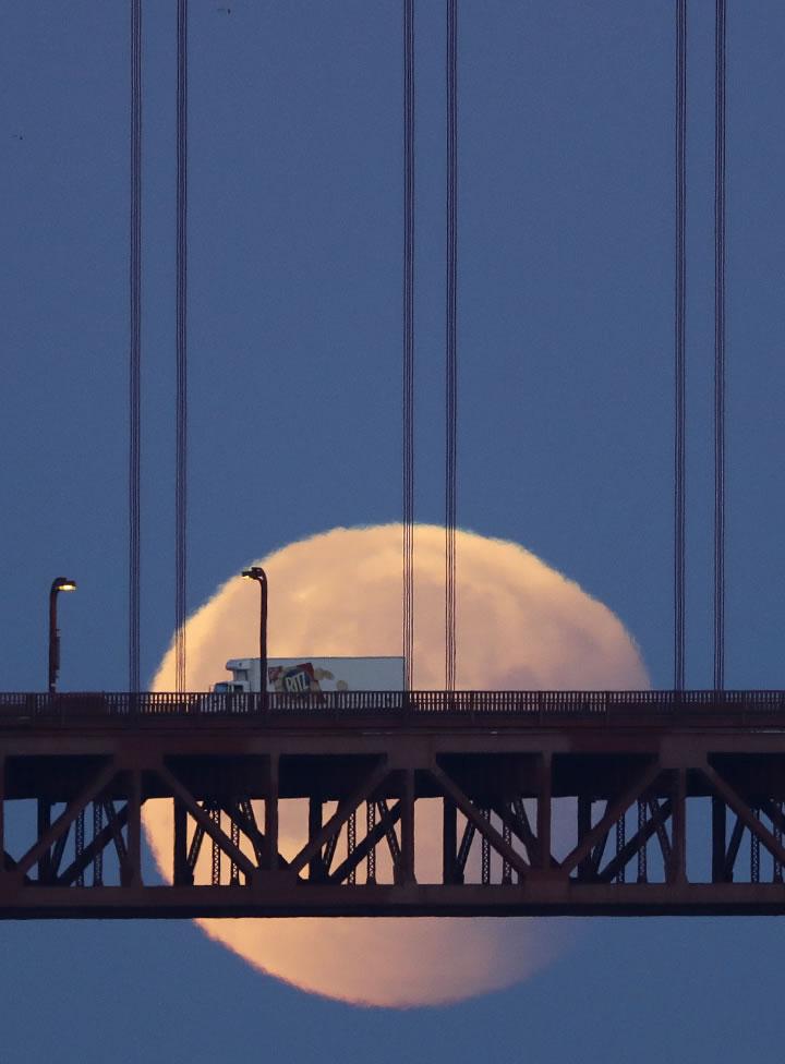 <div class='meta'><div class='origin-logo' data-origin='none'></div><span class='caption-text' data-credit='AP Photo/Marcio Jose Sanchez'>A super blue blood moon sets behind the Golden Gate Bridge Wednesday, Jan. 31, 2018, in San Francisco.</span></div>
