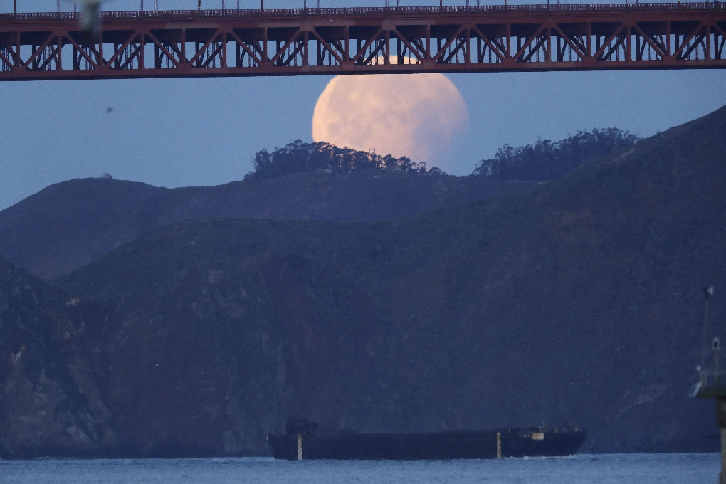 <div class='meta'><div class='origin-logo' data-origin='none'></div><span class='caption-text' data-credit='AP Photo/Marcio Jose Sanchez'>A partially-eclipsed super blue blood moon sets over the Golden Gate Bridge, top, and over the San Francisco Bay Wednesday, Jan. 31, 2018, in San Francisco.</span></div>