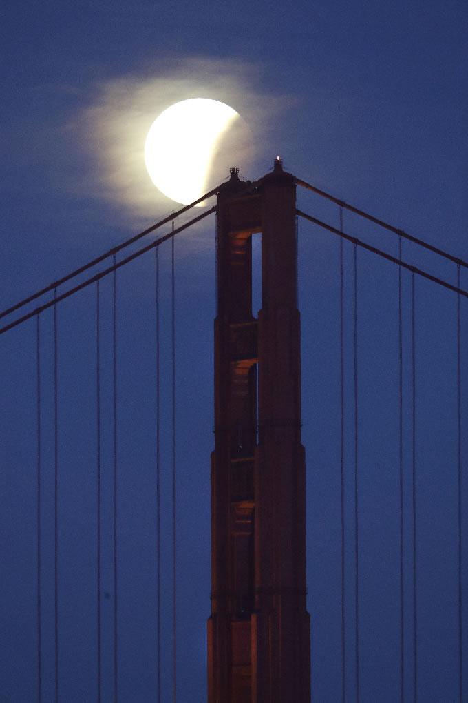 <div class='meta'><div class='origin-logo' data-origin='none'></div><span class='caption-text' data-credit='AP Photo/Marcio Jose Sanchez'>A partially-eclipsed super blue blood moon sets over the Golden Gate Bridge Wednesday, Jan. 31, 2018, in San Francisco.</span></div>