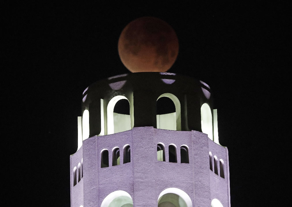 <div class='meta'><div class='origin-logo' data-origin='none'></div><span class='caption-text' data-credit='AP Photo/Marcio Jose Sanchez'>A partially-eclipsed super blue blood moon rises over the Coit Tower Wednesday, Jan. 31, 2018, in San Francisco.</span></div>