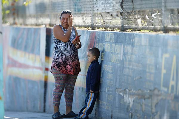 "<div class=""meta image-caption""><div class=""origin-logo origin-image ap""><span>AP</span></div><span class=""caption-text"">Elizabeth Acevedo and her son Andres, 3, wait for news of her son, Jose, an 8th grade student at the Belmont High School in Los Angeles Thursday, Feb. 1, 2018. (Damian Dovarganes)</span></div>"