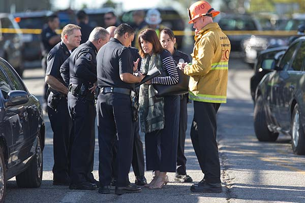 "<div class=""meta image-caption""><div class=""origin-logo origin-image ap""><span>AP</span></div><span class=""caption-text"">Los Angeles Fire department's Erik Scott, far right, police officers and school officials gather outside the Belmont High School in Los Angeles Thursday, Feb. 1, 2018. (AP Photo/Damian Dovarganes)</span></div>"