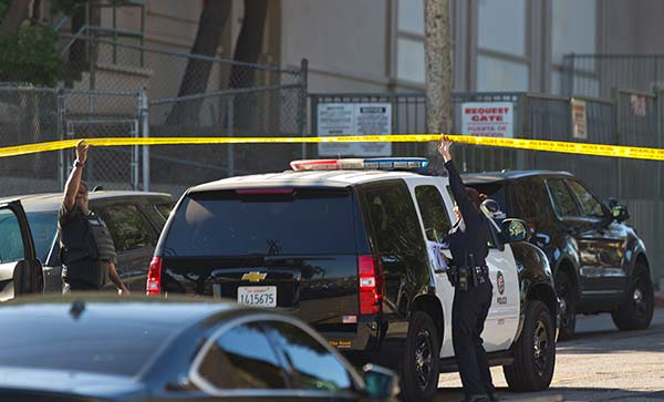 "<div class=""meta image-caption""><div class=""origin-logo origin-image ap""><span>AP</span></div><span class=""caption-text"">Los Angeles police cordon off the Belmont High School in Los Angeles Thursday, Feb. 1, 2018. (AP Photo/Damian Dovarganes)</span></div>"
