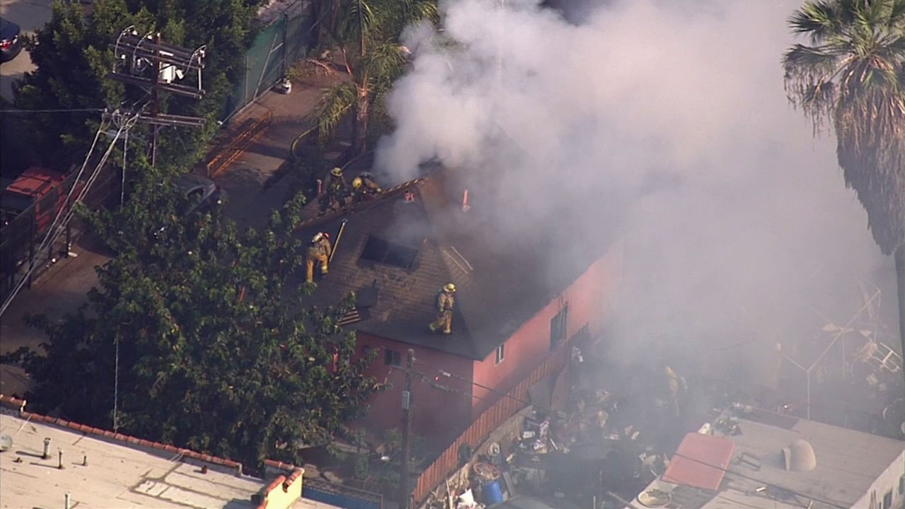 Firefighters battle a fire at a South Los Angeles house on Wednesday, Sept. 10, 2014.