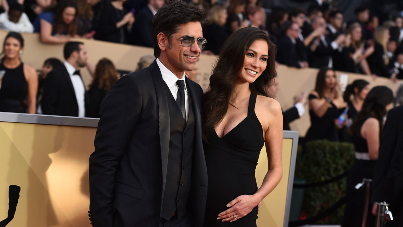 John Stamos, left, and Caitlin McHugh arrive at the 24th annual Screen Actors Guild Awards at the Shrine Auditorium & Expo Hall on Sunday, Jan. 21, 2018.