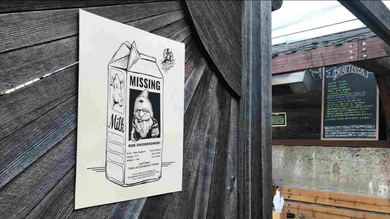 A flyer offering a reward for a missing gnome is seen outside the Connecticut Yankee bar in San Francisco on Saturday, Feb. 3, 2018.