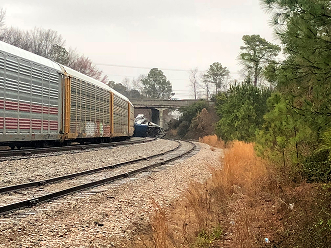 <div class='meta'><div class='origin-logo' data-origin='AP'></div><span class='caption-text' data-credit=''>A derailed Amtrak train sits on the track in Cayce, S.C., Sunday, Feb. 4, 2018.  (AP Photo/Meg Kinnard)</span></div>