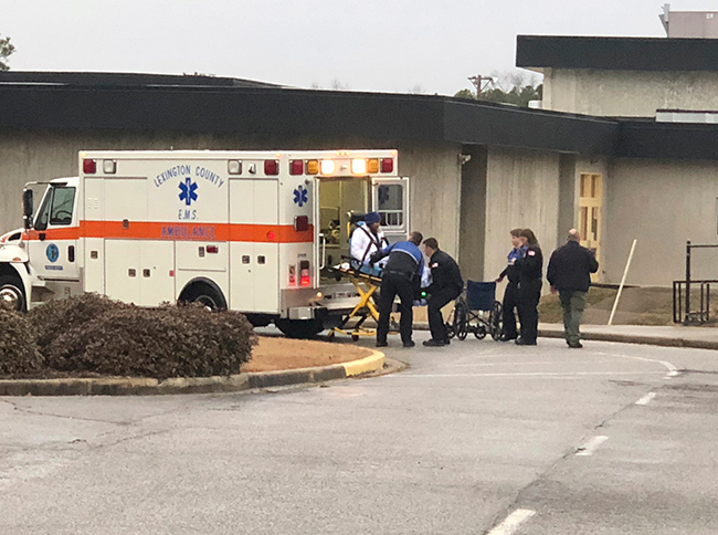 <div class='meta'><div class='origin-logo' data-origin='AP'></div><span class='caption-text' data-credit=''>An injured passenger from an Amtrak train derailment in Cayce, S.C. is moved from the Pine Ridge Middle School in Columbia, Sunday, Feb. 4, 2018. (AP Photo/Meg Kinnard)</span></div>