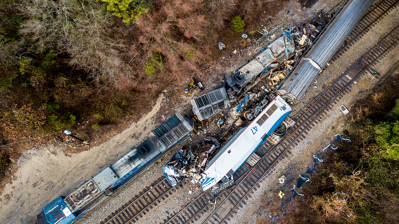 <div class='meta'><div class='origin-logo' data-origin='AP'></div><span class='caption-text' data-credit=''>An aerial view of the site of an early morning train crash between an Amtrak train, bottom right, and a CSX freight train, top left, in Cayce, SC.  (AP Photo/Jeff Blake)</span></div>
