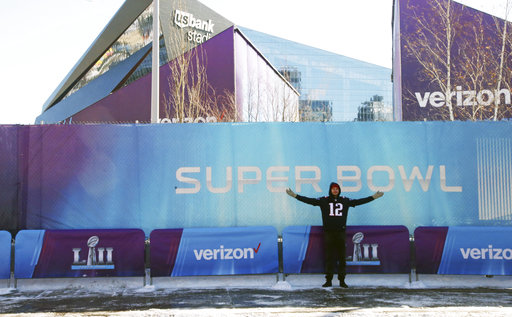"<div class=""meta image-caption""><div class=""origin-logo origin-image none""><span>none</span></div><span class=""caption-text"">A New England Patriots fan poses with U.S. Bank Stadium in the background before the Super Bowl, Sunday, Feb. 4, 2018, in Minneapolis. AP Photo/Jim Mone) (AP)</span></div>"