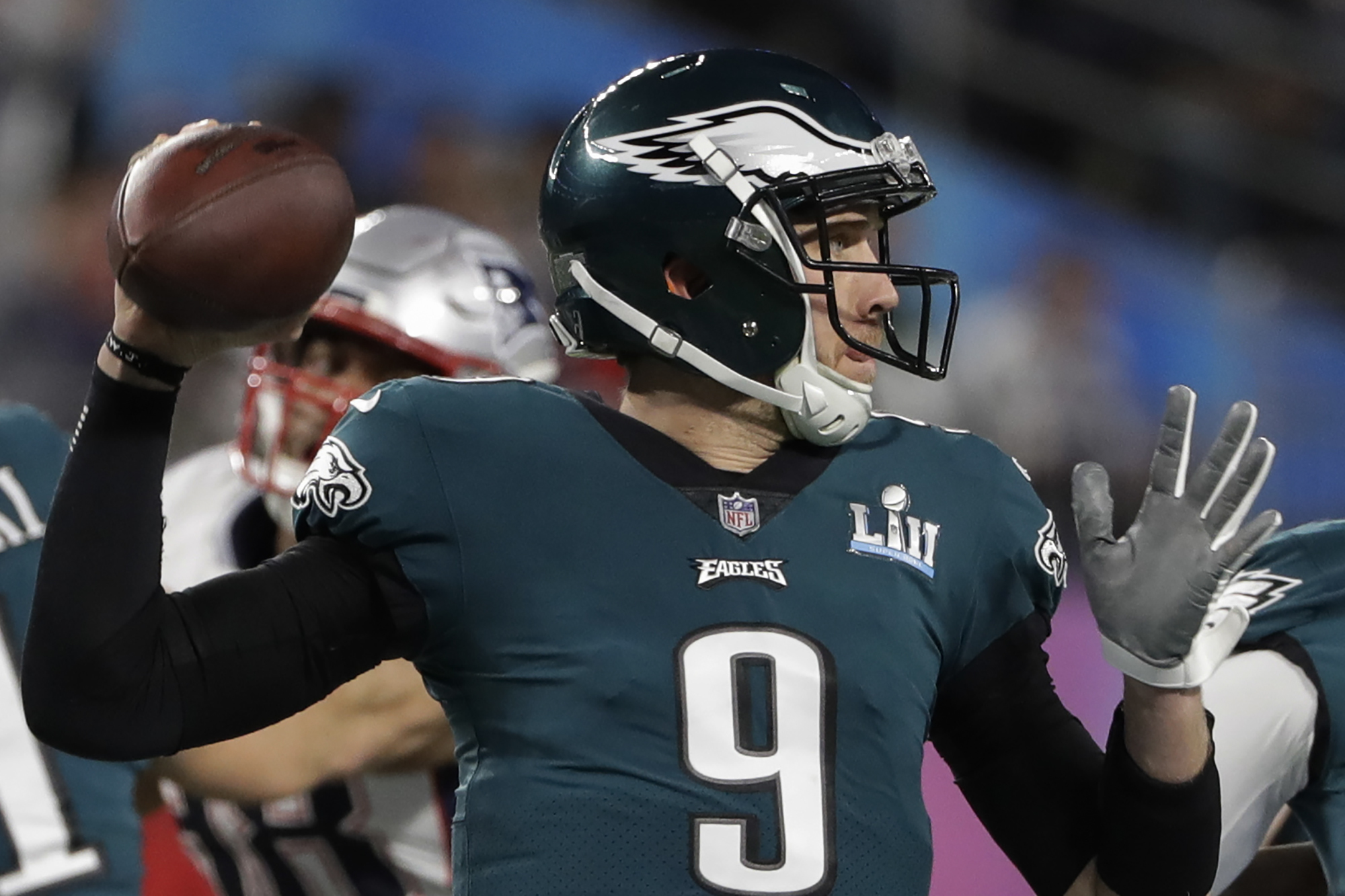 "<div class=""meta image-caption""><div class=""origin-logo origin-image ap""><span>AP</span></div><span class=""caption-text"">Philadelphia Eagles quarterback Nick Foles (9,) throws against the New England Patriots during the first half of the NFL Super Bowl 52 football game, Sunday, Feb. 4, 2018. (AP Photo/Chris O'Meara)</span></div>"