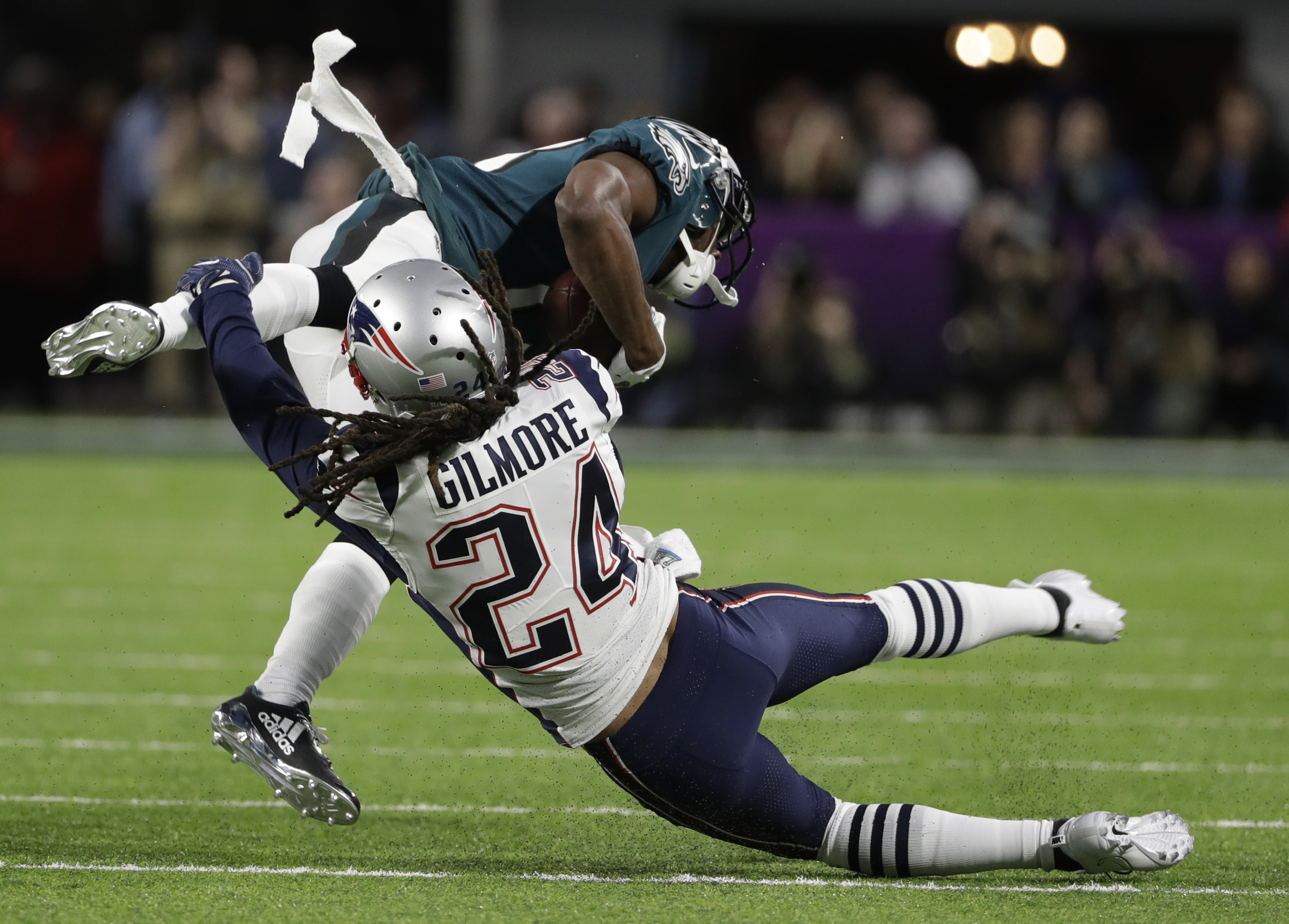 "<div class=""meta image-caption""><div class=""origin-logo origin-image ap""><span>AP</span></div><span class=""caption-text"">New England Patriots cornerback Stephon Gilmore (24), tackles Philadelphia Eagles wide receiver Nelson Agholor (13), during the first half. (AP Photo/Chris O'Meara)</span></div>"