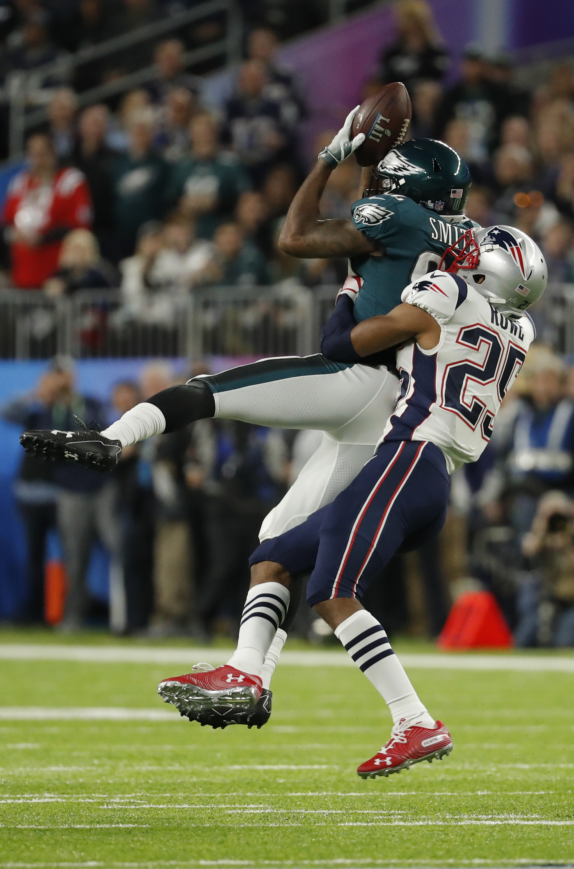 "<div class=""meta image-caption""><div class=""origin-logo origin-image ap""><span>AP</span></div><span class=""caption-text"">Philadelphia Eagles wide receiver Torrey Smith (82,) makes a catch against New England Patriots cornerback Eric Rowe (25), during the first half. (AP Photo/Chris O'Meara)</span></div>"