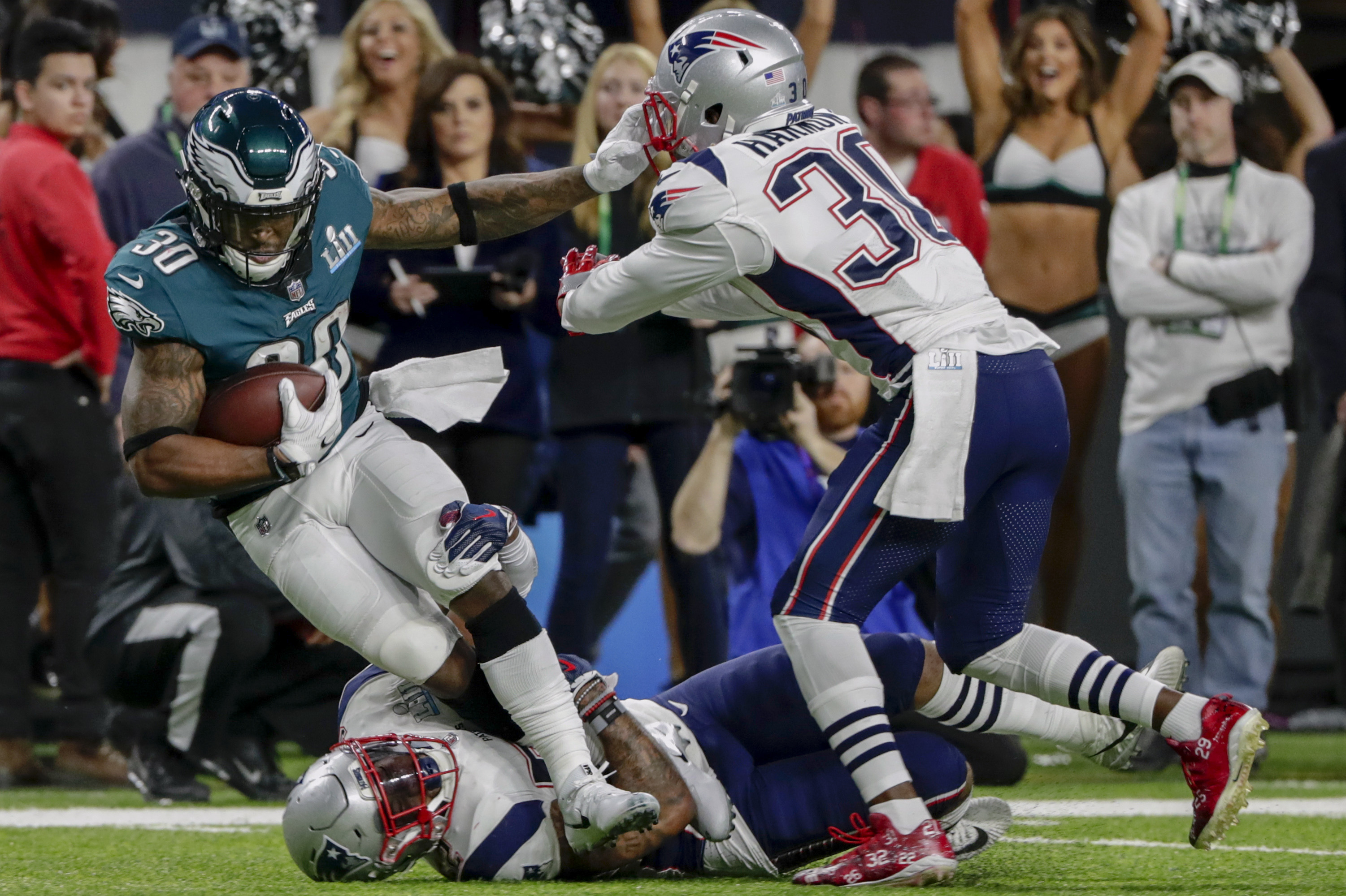 <div class='meta'><div class='origin-logo' data-origin='AP'></div><span class='caption-text' data-credit='AP Photo/Chris O'Meara'>Philadelphia Eagles running back Corey Clement (30), is tackled by New England Patriots outside linebacker Elandon Roberts (52), bottom, and strong safety Duron Harmon (30).</span></div>