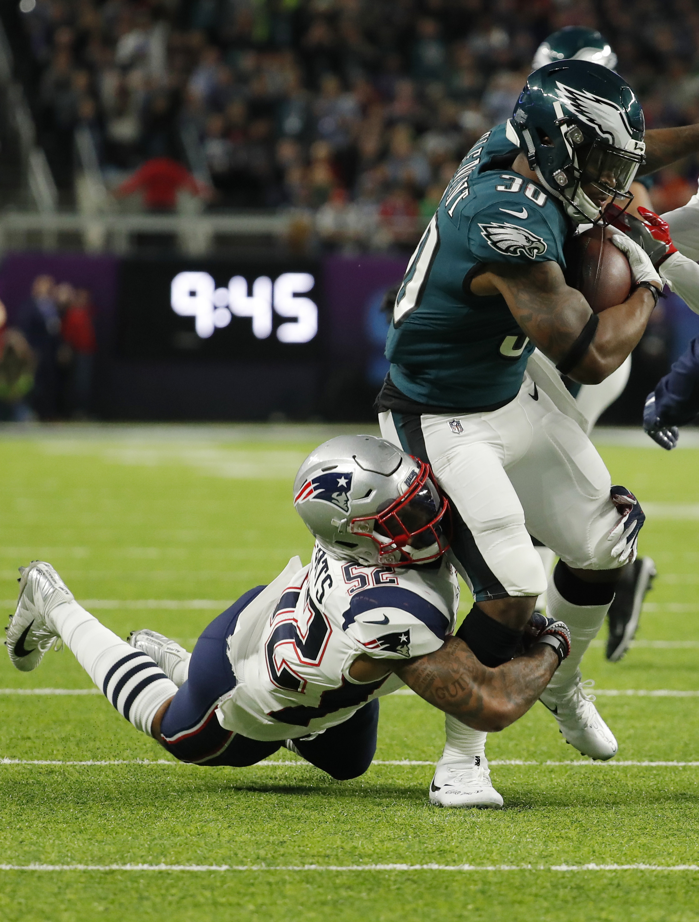 "<div class=""meta image-caption""><div class=""origin-logo origin-image ap""><span>AP</span></div><span class=""caption-text"">Philadelphia Eagles running back Corey Clement (30) carries the ball, as New England Patriots outside linebacker Elandon Roberts (52) makes the tackle, during the first half. (AP Photo/Chris O'Meara)</span></div>"