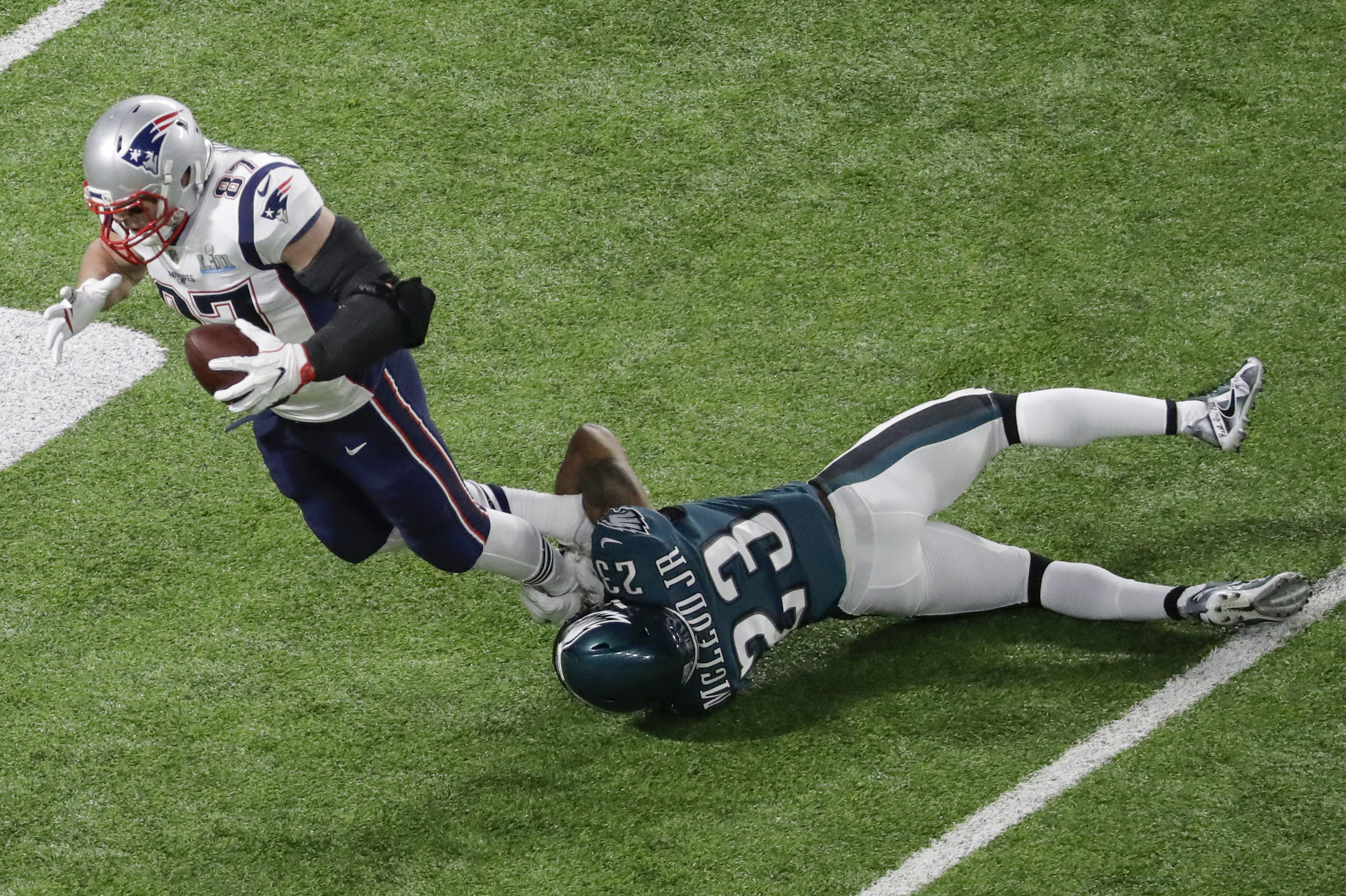 <div class='meta'><div class='origin-logo' data-origin='AP'></div><span class='caption-text' data-credit='AP Photo/Eric Gay'>New England Patriots tight end Rob Gronkowski (87) is tackled by Philadelphia Eagles free safety Rodney McLeod Jr. during the first half.</span></div>