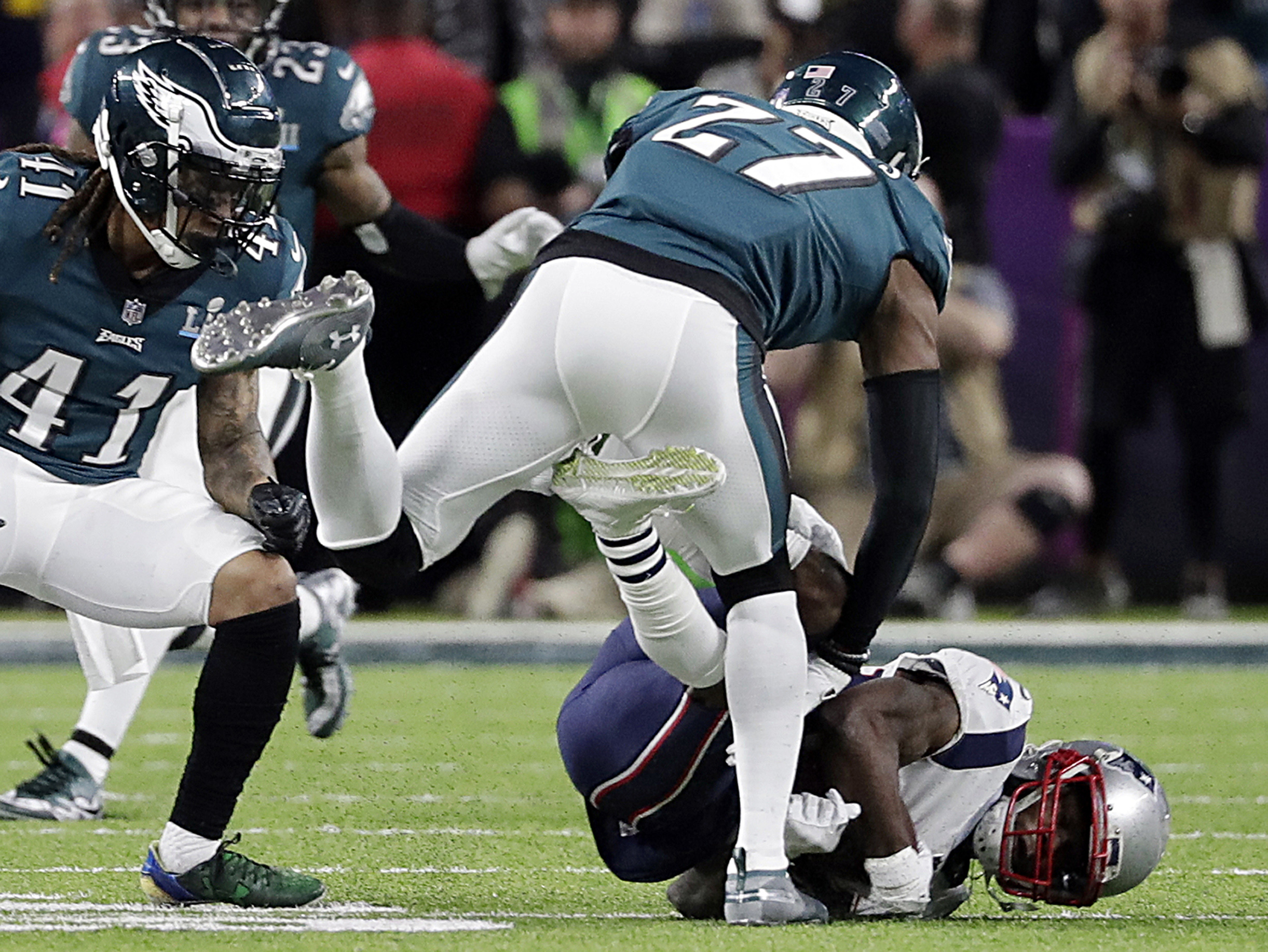 <div class='meta'><div class='origin-logo' data-origin='AP'></div><span class='caption-text' data-credit='AP Photo/Tony Gutierrez'>New England Patriots wide receiver Brandin Cooks (14), falls after colliding with Philadelphia Eagles strong safety Malcolm Jenkins (27).</span></div>