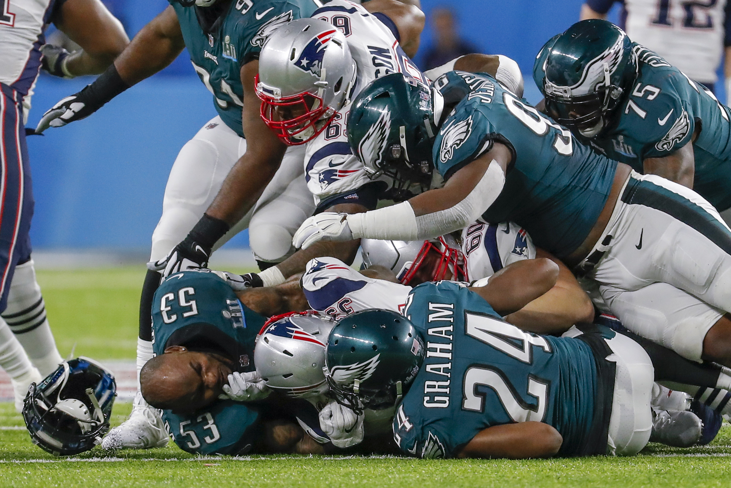 <div class='meta'><div class='origin-logo' data-origin='AP'></div><span class='caption-text' data-credit='AP Photo/Charlie Neibergall'>Philadelphia Eagles outside linebacker Nigel Bradham (53), loses his helmet as players pile up on a play during the first half of the NFL Super Bowl 52 football game.</span></div>