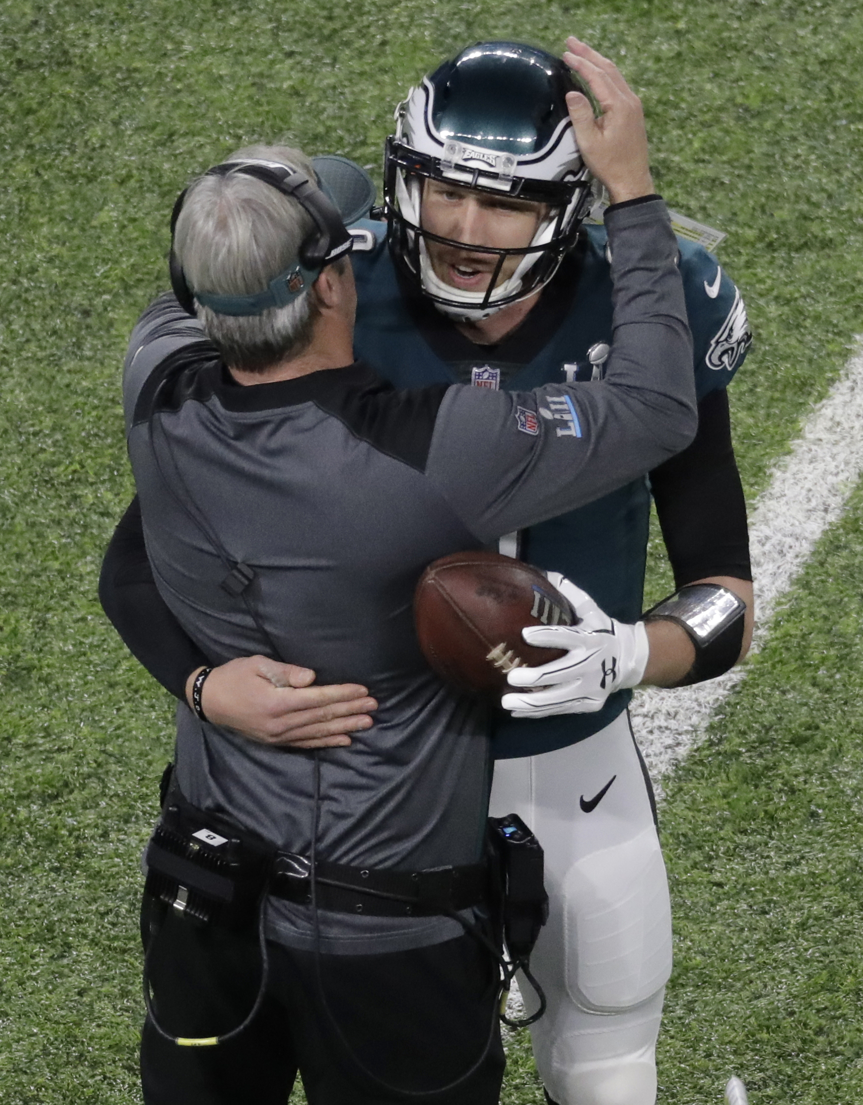 <div class='meta'><div class='origin-logo' data-origin='AP'></div><span class='caption-text' data-credit='AP Photo/Eric Gay'>Philadelphia Eagles quarterback Nick Foles celebrates with Eagles head coach Doug Pederson after scoring a touchdown during the first half.</span></div>
